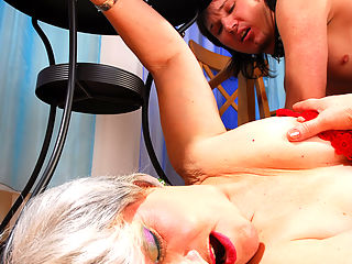 Its obvious that grey-haired mature Renee is the one whos in control here. Her young toy-boy, fully naked and collared, is getting trained like a good puppy. She wants him to worship her legs before she can trample him, then she wants to feel his tongue on her mature jugs and worn out snatch. This old fatty almost smothers the boy with her cunt before giving the oral favor in return and spreading her heavy nyloned thighs for him.