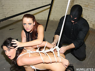 Eva gets tied up and cummed on in a dirty old warehouse