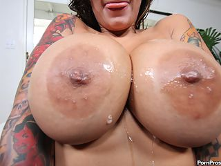 Wild tattoo slut with enormous jugs fucks stud into the ground