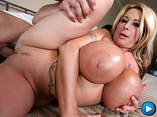Blonde slut with freakish huge boobs gets pounded!