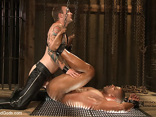 Christian Wilde beats, torments, and fucks his body builder captive : Ripped body builder Robert Axel awaits in the dungeon, bound and gagged as Christian Wilde approaches. Christian tears away his subs clothes, revealing his chiseled body. After some impact play, Roberts gag is removed for him to swallow Christians giant cock. Roberts cock is raging hard as hes bound for his masters delight. Christian edges the muscled studs cock before tormenting his balls, weighing them down with as many weights as he can fit. As the weights pull, Robert is beaten with the crop before being bent over to receive his masters cock. With his hands tied to the ceiling, Robert is oiled up as Christian beats him front to back with the flogger. With a final fuck, Christian milks a load out of the studs cock before dousing Roberts entire body with his cum.