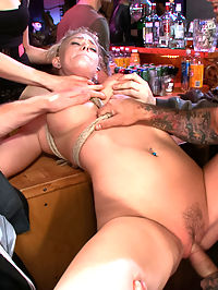 Beautiful Petite Blonde Tied-Up and Fisted in Public : Allie James is a gorgeous little blonde with perky tits and a firm round ass. Lorelei Lee ties up this cute girl and drags her to a bar where she is fisted, fucked, slapped, spit on, disgraced, and fondled by strangers.