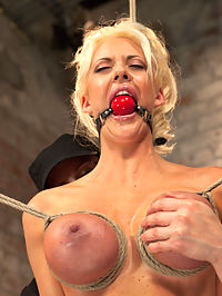 Busty California Blonde Courtney Gets Bent, Fucked and Challenged! : What do you do with a hot tan babe with an amazing rack that is lively, eager, and ready? One of Claires favorite activities is binding womens breasts. The tautness of the boobs swelling, looking so plump and ripe, peaked with color and pushed to the max. The humiliating aspect of controlling a woman just by her breasts is a huge turn on. In scene one, Courtney starts with her hands bound behind her back sitting in a chair. The bondage gets more complicated and eventually she is transitioned into a standing breast and hair bondage predicament. If she loses balance she will either put a lot of uncomfortable weight on her hair or her breasts. Its incredibly hot to watch this bitch struggle and even more hot to see her cum.Second, from her athletic experience, she is a flexible forward bend lady. She is a pleasure model, not inclined to much pain, but Claire wants to give her a good taste of discomfort by caning and tickling her feet. Adding clamps to her labia and then attaching them to her nipples, it discourages Courtney from wanting to struggle, so of course the pain game continues. After thoroughly enjoying her discomfort its time to see her live up to her pleasure model title. Orgasms are ripped from her cunt and clit in an inescapable frenzy of pleasure. The comfort of her chair is taken away and she is suspended in the complete forward bend unassisted with no choice but to continue to focus on the incredibly distracting pleasure of Claires hand and the vibrator.Finally she is bound to the throne with her statuesque body and amazing curves on display. She gets to experience how uncomfortable the pantyhose hood is. Leather is wrapped around her tiny neck at attached to the pulley. She also gets an introduction to the tazapper. Taking it like a champ, she impresses Claire enough to have the vibrator locked on her cunt to be turned on. Immediately multi orgasmic Courtney is already begging to cum.