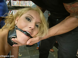 Tiny blonde deflowered in sleazy sex shop. 1st ever porn shoot! : Whats a tiny blonde doing inside of a sleazy sex shop filled with nasty horny guys? Luna Light is getting disgraced in public for her first ever porno shoot! She is dragged inside and swarmed by pervy men ready to fulfill the fantasies they came here for. Luna makes the perfect little blow-up doll as she gets tossed about the room bouncing up and down on a huge cock. She crawls around on the floor and sucks dirty dick while getting her tiny tits grabbed and her whore pussy tormented with a vibrator. Hot woman fuck her holes with dicks on sticks. The highlight of the show is when she gets dragged into a dark booth, blindfolded and pounded through a glory-hole. Covered with cum and her own filthy squirt- Lunas first porn shoot is a success!