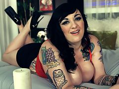 Tattoo Exploration : Scarlet LaVey is one of TSGs most inked models with Dors Feline, Marilyn Mayson, Lolly Ink and Sabrina Linn. Scarlet got her first tattoo when she was 18 years old.br br In this special video, Scarlet talks about the origin and personal meaning of some of her many tats. She describes the process of being tattooed and what its like when shes on the artists table.br br What drew Scarlet LaVey to skin art and what drives her to delve deeper into this form of extreme body modification? What kind of tats and pictures does she like?br br Why does she, like other tattoo enthusiasts, turn her body into a canvas for living art in the first place? Whats behind her motivation and what draws her into the world of illustrated people? What body parts does Scarlet say shell never tattoo?br br These questions and more are answered by Scarlet LaVey in the special video Tattoo Exploration.