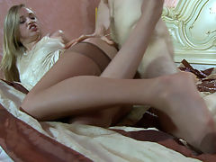 AmyA and Gerhard kinky nylon feet video : Amy A. fell asleep in her control top pantyhose, but her boyfriend Gerhard sneaked into the bedroom and woke her up by massaging, licking and sniffing her nyloned feet. He literally could not get enough of them greedily rubbing them against his face and enjoying their musky aroma. Then he flipped the girl over and entered her pussy just slightly lowering her tights before getting a nice nylon footjob.