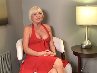 The Scarlet Andrews Interview : Having made the photo sucking and fucking version of her 60PlusMILFs.com debut, sexy 65-year-old Scarlet Andrews sits down for an interview and tells all. Scarlet is wearing a red dress she calls her Marilyn Monroe dress, although Marilyns was white, and Marilyn was wearing panties. Scarlet isnt, which is one of the reasons we say her husband, who accompanied her to our studio and watched her fuck a 21-year-old stranger, is a very lucky man.br br He likes the fact that I can be a little on the wild side but still play the Southern belle, she says.br br These days, Scarlet is living in Tampa, Florida, but she was born and raised in Birmingham, Alabama, a place where the women are very conservative and dont generally walk around without panties.br br Alabama was just too rigid, so I went to college and came out of college and became a flight attendant, Scarlet says.br br And thats when the interview heats up. Scarlet has a lot of sexy stories about being a flight attendant, and when you hear them, you wont be surprised that she came to our studio and fucked a guy whos 44 years younger than her.br br Actually, after you see this interview, nothing Scarlet does will surprise you.br