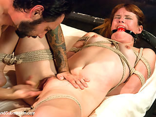 Broken Down Redhead Slut Face Fucking and Anal Sex in Bondage! : In this fantasy role-play, Claire gets tied up and endures face fucking and hard sex when she visits her brother-in-law at the BDSM studio where he works. First she is bound in a back arch position and Tommy strips her down and goes to town on her throat. Then in rope bondage, Claire gets some good anal pounding and has uncontrollable orgasms. Lastly, she is completely restrained with her legs spread open and fucked until he comes on her face!