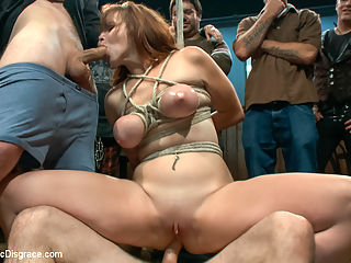 Bella Rossi Returns : Big tittied ginger fucked in the ass in front of a horny crowd!