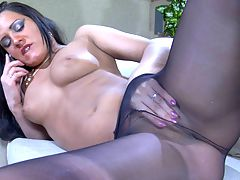 AprilB pantyhose tease movie : April B is having phone sex while slowly stripping her sultry red dress and remaining just in her barely black tights and hot stiletto heels. She keeps talking while sitting herself on the sofa and spreading her pantyhosed legs wide to rub her itching nylon pussy. Then she slides her hand under the sleek nylon material and fingers her slit to orgasm letting her partner hear her moans of pleasure.