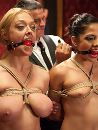 Bit Tits Blonde Slave Suspended for Anal Fuck vs. Petite Cock Sucker : Two new slaves appear on the Upper Floor, but we can only keep one of them. Is it going to be the big tits anal fucking bondage slut, Darling? Or the petite small tits cute brunette Evilyn Fierce? The Upper Floor puts both petitioners through their paces to get to the bottom of it. Darlings giant tits are tied tight, and her ass is put in a sling. We get all her holes fucked and sucked as she dangles from the ceiling like a slutty, fuckable sex doll, taking her to her limit of endurance for bondage, sex and orgasms.Meanwhile, the other slut is proving to be a nimble yet sloppy little cock sucker as she devours Mr. Greys freakishly huge cock down her pretty little throat. He continues to use the slave wanna be fucking her all over the damn place will we finally tie her down for the finale.We bring it all together in a super sexy boygirlgirl fuck fiesta of bondage and service that is designed to separate the slaves from the sluts. In the end, we can only keep one of them - which will it be?