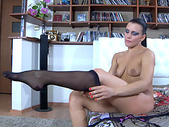 Sibylla teasing with her stockings : Keep a pack of tissues at the ready when youre going to watch Sibylla teasingly slowly putting on her classy black nylons, buckling her sexy spike heels and putting a small suspender belt around her waist. This babe knows everything about rousing nylon tease, and she is really good at it. Get ready to feel some serious stirring in your pants as this tempting chick flaunts her stockinged legs.