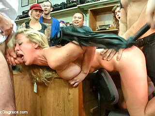 Hot blonde fucked and disgraced in a typewriter shop : Cherie is dragged into a stuffy typewriter shop and stripped in front of the unsuspecting patrons. They decide to stay for the show and watch as Cherie gets humiliated and fucked. She is subjected to an electric butt-plug in the ass while being pounded with huge cock and teased with the violet wand all at the same time. As a reward she gets to lick Donnas hot cunt and make her cum.
