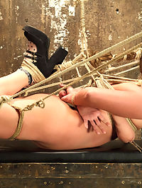 Double Penetration Anal Whore Gets The Squirting Shocker! : Sexy Roxy Raye loves it in the ass, and she gives up great anal orgasms in tight bondage for HogTied members. Roxy starts out in a strict, classic hogtie that only gets tougher. As the tie progresses, her thighs are tied wide apart so I can fuck her hot pussy with a dick on a stick and vibe her clit into uncontrollable orgasms.Doggie Style Anal Fuck is next up. Roxys ass gets tied open, filled and fucked with a giant clear butt plug. Her pussy is vibed while I fuck her ass and make her come over and over in the tight doggie tie.The Squirting Shocker tie subject tightly into inescapable bondage, jam two in the pussy, two in the ass and fuck till copious amount of pussy juice is squirted all over the floor.