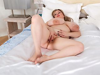 Arctic Nights : We see very big things ahead of huge-chested Antica so we asked the sexy blonde back to make her third appearance at XLGirls in a new pictorial and matching video. Fortunately, she was all for it. This time, our photographer found a cool, funky, unusual location that looks like Supermans Fortress of Solitude.br br As mentioned before, Antica was discovered by sheer happenstance. Our man was exiting his apartment building when he saw her. Instead of gawking and seeing her pass by, he handed her his card and after some hesitation, Antica decided to give it a go.br br Antica was a vendor in a grocery store selling wine and liquor. Nice job, but she is so much better-suited to showing off her ripe, robust body than working in a store.br br Antica said she began developing at the age of 16 and was already a D-cup at that time. Her breasts began to really sprout when she was 17. Now at 23 years old, she is a 38G! Yet Antica says she was not the bustiest girl in school!