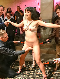 First boygirl scene ever! : Micah Halili looks so sweet with her braces and shy smile. A large crowd gathers to see her first time taking a cock in public. What a slut! She begs for the cattle prod on her ass hole and pussy and cums uncontrollably. The audience takes turns fisting her and she gets flogged and fucked with her head in a box. She didnt know what to expect but she loved what she got.