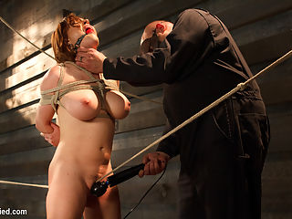 Big Titted Torment : Krissy Lynn and her gorgeous, huge tits are taken for the ride of her life by Sgt Major. She is strictly tied to the ground, put on a tormenting crotch rope, and hung in the air before being fucked silly and being made to cum like a freight train. All aboard, Krissy.