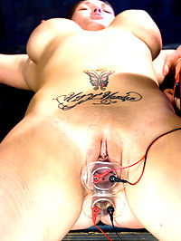 Big tit brunette gets tied up, shocked and fucked by Lorelei Lee : Claire Dames is strung up helpless, then shocked and made to cum by super hot Mistress Lorelei Lee. These two babes have smokin hot chemistry in this update filled with tight bondage, big tits, electrical toys, strong vibrators, pussy licking, dildo gags, and more!!!
