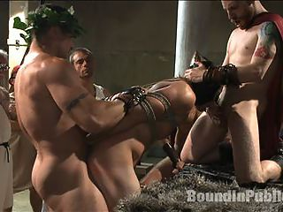 When in Rome, torture and gang bang! : Gladiators with bull cocks Trenton Ducati and Connor Maguire continue to punish the criminal Kip Johnson. They whore him out to all of Rome. Taking turns fucking Kips sweet ass, the crowd torture the poor boy with hot wax and then gang fuck him relentlessly. The horny Romans shoot loads after loads on his face