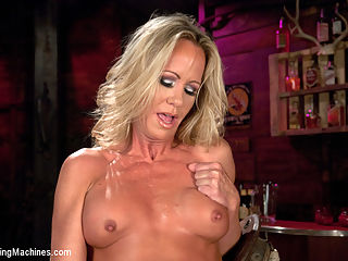 MILF MACHINE - Simone Sonay Takes on the F Machines : Simone takes on the machines in a return visit to our cowboy bar. We fuck this tight body MILF every which way - standing up, in the arse, the pussy, laying down, doggie and spoon! Simone is the kind of woman who has been having orgasms for long enough to know exactly what she wants, how to ask for it and how to tell us to do it her way or get out of her pussy. And just take a gander at the cock size she stuffs into her pussy - now that is a woman on a mission to cum!