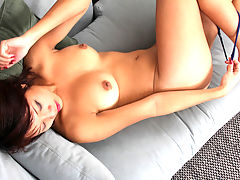 Asian amateur Valerie Jones bucks her hips as she nears orgasm