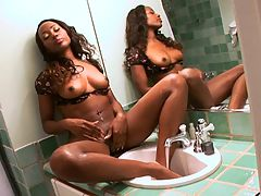 Black Legs In the Bath : Saphira Chanel treats you to a feast of feet and flesh as she sits perched on the tubs edge and soaps and rinses her long mocha legs and peds. This sultry, ebony queen slowly caresses the suds into her skin and then works the soap between her digits. And wouldnt you love to slide your big cock between her slippery toes? Then she dries her legs and sits on the counter so that she can coat her gams with shaving cream and then shave for you. Youll love the contrast of her chocolate skin and the white foam as she lovingly shaves. Once her legs are bare, she doffs her panties and starts rubbing her fingers over her clit and between her slit because since you are watching, she wants to cum for you. Watch this beauty go at it, right down to the moment she cums and then swings her legs happily, as if she didnt have a care in the world.br