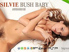 Silvie Bush Baby : Heres your chance to climb in between the sheets with bush-baby Silvie the perfect end to our special Silvie week we would say! With no inhibitions and proud of her sexuality it seems that Silvie is in the mood for some pleasure. So watch and enjoy as she plays with her wet, unshaven pussy - and believe us, Silvie is not the kind of girl to hold back! Another scorching hot film featuring our exciting new model dont miss it!