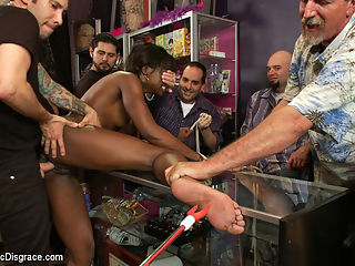 Disgraced. Twice! Ana Foxxx takes it all. : Isis and Tommy have big plans to fuck and disgrace Ana in a building supply store. It all works out, complete with a crazy milk swallowing scene, until the boss returns and kicks them out. Little does he know that his employees have been cumming on whores while on the clock! Not to be deterred, Tommy and Isis drag Ana into a crowded head shop and give the patrons a show to remember. Pussy pounded, face fucked, electricity, strap-on fucked by Isis Love. First Public Disgrace!