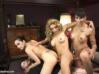 The First EVER TS GANG BANG on TsSeduction.com - The Gangster Gangbang : TsSeduction.com presents a feature shoot starring Jessica Fox, Jessy Dubai, Honey Foxxx gangbanging Sebastian Keys and mouth fucking newcomer, Jimmy Bullet. This shoot is the first ever gangbang on TsSeduction and it is incredible. The best thing about a TsSeduction gangbang is that everyone gets fucked - the Ts women fuck each other and they all tear up their man meat, cumming all over his backside. Be forewarned - if you think about this shoot after you watch it, you are likely to get a boner in public just reminiscing about the sex and the hard cocks of these fine ladies. The sleepy hollow of Landsend, New York is the perfect place for hustlers - the port access, the unsuspecting community of soccer moms and commuters, cheap waterfront property and above all, small time cops. Cops that are looking to make a bust big enough to get them noticed, get them promoted to the NYPD. The Queen Pins in this operation certainly do not fear the local police - they fear no one. They have heat of their own tucked away in the panties. When the two green cops try and bust into the warehouse fortress, the women barely care. All they can see is a new asshole to fuck, a new backside to cum all over. The cops botched attempted at arresting these big time criminals ends with them both cuffed and giving up their holes for the taking. Honey with her massive cock fucks everyone, Jessy with her sexy dominating style cums all over the face of one cop and all over the backside of the other. And Jessica Fox shows her horny self off in hot fashion as she anchors the double anal penetration and sucks all the girls cocks. Its a palooza of sex and so hot and complicated and involved, that you can watch this update 100 times and still see something different.
