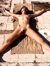 Bound for the Apocalypse Part 2 : Sex and Submission presents Part 2 of Bound for the Apocalypse, a Feature Presentation. Darling is naked and alone in the desert after escaping the chains of a cruel post-apocalyptic hunter only to be captured by another hunter who uses his sex slave, Marica Hase, as bait. Beautifully shot in a spectacular outdoor desert location and abandoned house. Includes role-play, anal sex, bondage and corporal punishment!