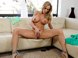 Stunning cougar Brandi Love shows off her huge boobs and athletic body in a tiny thong and then uses both hands to bring her craving cunt to body shaking orgasm