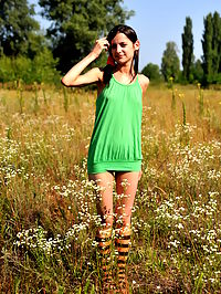 Marvelous girl outdoor : Marvelous teen girl in striped socks undressing and showing slender body on the nature.