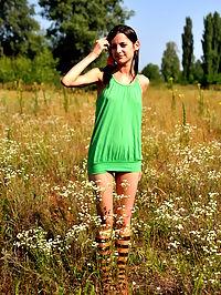 Marvelous girl outdoor : Marvelous teen girl in striped socks undressing and showing slender body on the nature.
