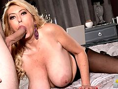 The big-titted MILF takes on a big cock : Do you really think my breasts have gotten bigger? and 820049-year-old MILF Tahnee Taylor said when she returned to our studio. Im still wearing the same-size bras.br br Yeah, and 8200we said, but do they really fit?br br She thought about that for a second and said, You may have a point. Whatever, theyre big.br br Really big. At least DDD-cups. Maybe larger.br br I just find a bra that fits and wear it, Tahnee explained. I and 8200usually dont even look at what size it is.br br In this scene, Tahnee has the good fortune of being paired with JMac, a big-cocked cocksman who really loves big tits. He sucks on them hard and long, and she likes it. She also licks her own tits.br br But, because at 40SomethingMag.com we appreciate all parts of a womans body, JMac also fingers her asshole. Then Tahnee sucks his cock, and this time were lookig up at her big tits and dick-sucking mouth. She wraps her huge naturals around his cock, then gets ready to be fucked hard by big cock. Of course, when JMac fucks Tahnee from behind, her tits jiggle like crazy. And when he piledrives her shaved pussy, her tits avalanche back into her face.br br Where does he cum? On her tits, of course. Theyre big targets.
