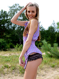 Cute long haired honey : Amazing long haired teen honey with a slender figure taking off clothes and posing naked.