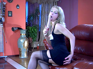 Felicia C awesome nylon movie : Playful blonde Felicia C slides her huge plastic dildo into her cleavage and gives it a good lick while flashing the tops of her black suspender nylons. Then she gets on her knees on that huge leather sofa and shoves her toy into the rectum right from behind. Later you will see her parting her stocking clad legs wide on the sleek leather cushions rubbing her hairless pussy and fucking her back hole up to orgasm.