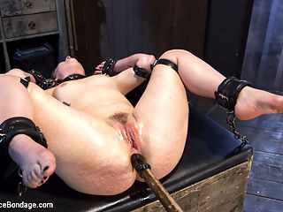 Hot Red Head Gets Tormented and Ass Fucked : This is our edited Live shoot from July. Claire is a super hot red head that loves bondage. She gets paired up with Orlando, his sick mind has been working on evil shit to torment this little whore with. First, he has set a trap for Claire, where she is blindfolded, turned in circles to disorient her, then she has to back into one of three surprises. Next she is put in a rigid device that keeps her perfectly still. Her head is covered in a latex hood and the torment continues in the form of tickling her until it becomes breath play. The floggers come out and redden her milky skin, then her cunt is filled and vibed.In the final scene, she is on her back and spread wide. Bastinado is served up this time, along with other torment, to push Claire to the edge. She thinks that she is at the end of the line, and then Orlando crams her ass full of a dildo and fucks her into full submission.