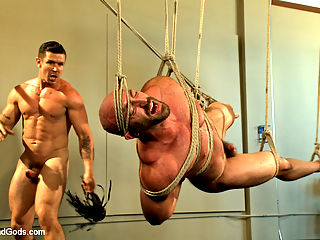 Bondage Boot Camp Workout : Creepy Handyman Trenton Ducati is working away in the gym when muscled hunk Tatum walks in looking for the 1 o clock boot camp. Being a handyman, Trenton knows nothing about boot camp workout but he decides to give it a whirl. Trenton puts Tatum right to work with push-ups after some negotiation with the cattle prod. Bound to the bench, Tatums made to lift heavy weights as the creepy handyman gets his cock rock hard. Trenton zaps the muscled stud as he rams his hard cock deep into Tatums ass. To work on his cardio, Tatum is chained to the treadmill with weights clamped onto his nipples and balls. Finally, Tatum is horizontally suspended in mid-air as hes made to swallow Trentons giant cock. After enduring a heavy flogging, Tatum opens his hole once more for a rough ass fucking before receiving Trentons cum all over his face.