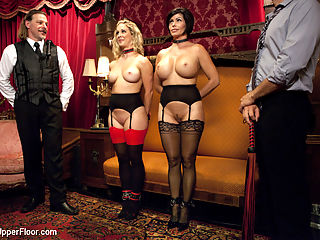 Cock Service by Two Hot MILF Slaves : Two hot MILFs Cherie Deville and Shay Fox service hard cock on the Upper Floor