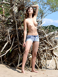 Cute honey stripping : Gorgeous teen honey stripping and posing in the nude with lucky aborigine on the seaside.