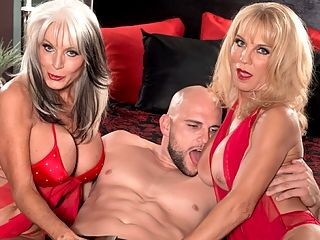 Cara, Sally and a big, fat cock : Sally DAngelo, 60, and Cara Reid, 61, both big-titted blondes, both married, both horny all the time, both swingers even though they didnt know that about each other when they were just biker buddies share a cock, and each other, for the first time.br br I and 8200love me some Sally, Cara said. I think it is going to be so much fun. It makes me hot just thinking about it. Im going to take my cue from her and surprise her. Throw her down and lick her pussy good. I hope she lets me. And Im gonna let her lick mine.br br When this scene opens, Sally and Cara are both looking hot in red fuck-me lingerie. Sally gets Cara ready for JMacs big cock by licking her tits and eating her pussy, and it isnt long before theyre both sharing that big cock and eating each others pussies and feeding JMacs cock into each others pussies.br br What are the odds that a couple of motorcycle friends who used to go riding with each others husbands would end up fucking at 60PlusMILFs.com?br br I never knew about Sally because she was always worried that I would be offended, and when she told me, I was like, Oh, god, this is awesome, Cara recalled. And she said, I was afraid that you wouldnt like me anymore, and I said, I love you even more now.br br Sally and Cara love each other so much that at the end of this scene, they lick JMacs cum off each others faces and tongues. And thats what friends are for.