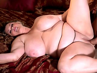 Sticky Kimmie : Kimmie Kaboom will make you go kaboom in your shorts.br br Its her first day on the XL Girls set and she says shes looking forward to getting fucked. We love a bold and sexy woman who tells it like it is. Its Kimmies first time having sex on-camera, a major event for any new model. We know without even seeing this that she will be awesome.br br Kimmie is looking forward to being fucked from behind, one of her favorite positions. Knowing that Im being filmed makes me feel sexy and desired, says Kimmie who admits to being nervous, something completely natural.br br Tony D. is going to guide Kimmie through her first fuck. He sucks, kisses and squeezes Kimmies bigger-than-big 42H boobs and helps her undress. His hands cannot wrap entirely around Kimmie hooters. They are sensational.br br Kimmie unzips him and takes his stiffy out. She slowly licks the head and balls, sensuously and erotically. Tony drives his skin-train through Kimmies titty-tunnel and bangs her boobs hard. His shaft practically disappears between her massive mams.br br Kimmie lies back on the bed so Tony can bury his cock inside the blonde hotties tight and wet pussy, building up speed and depth to hammer her good, only stopping to lick her sopping-wet taco.br br Kimmie holds her shaking breasts with both hands as her new fuck partner pounds her furiously. The room fills with the sounds of her heavy breathing and moaning. Its a spectacular first sexing. Kimmie is in good hands as they try out different fucking positions.br br Is Kimmie a spitter or a quitter? Find out in Sticky Kimmie, the first hardcore scene of this great new discovery!