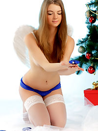 Inviting shaved quim : Superior long haired teen angel showing off her inviting shaved quim near New Year tree.