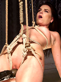 Pretty Little Rope Slut Gets Destroyed : If you enjoy bondage you already know Juliette March, the pretty little pain slut from next door who can never get enough. Hogtied gives Juliette close to too much in this hardcore update featuring multiple suspensions and painful orgasms.First scene finds Juliette spread eagle on the floor getting flogged nonstop until she is hoisted into the air in a reverse backbend. With the hands and feet bound to four corners, there is nothing she can do to stop the big dildo ramming her pussy and bringing a barrage of relentless orgasms.Second scene Juliette is suspended like a little dolly in a crucifixion. Her begging eyes are almost comical as more weight and clamps are left to hang off her sensitive pink parts and tender nipples. We rip a few more screaming orgasms from this masochist before she is left hanging in the air. Third Scene we hanging Juliettes now swollen pussy at fucking height and take her for a serious ride while she is trussed up like a little package. It would not be Hogtied if we didnt feed these slutty bondage whores tip they cant take anymore. Thanks Juliette.