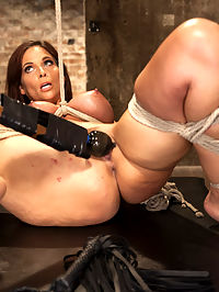 Big Tit MILF Syren de Mer Gets It Just the Way She Likes It : Sexy Syrens irresistible tits are tied tight and weighted in an orgasmic predicament scene that pits her will against her own pussy. Once the ice is broken, we tie her down for a good old fashioned bound pussy fucking till she blows her load of squirt all over the floor. Last but hardly least, we feature that fine fucking ass with the biggest dick in the cart in a suspended ass fucking scene.