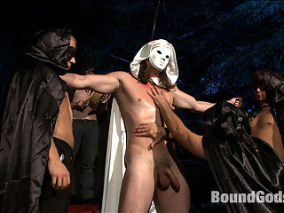 The Cabin Prequel - The Red Moon Festival - Part Two : For Halloween and in the continuation to The Cabin Prequel Tatum wakes to the sound of far away drums after having a sex dream about his business partners son, Kip. Following the hypnotic beat, Tatum stumbles across the Red Moon Ceremony where a group of men in masks worship a hot studs body. Tatum cant turn away as the men suck and fuck the masked hunk while covering him in hot wax. Tatum, realizing hes overstayed his welcome tries to sneak away, only to be caught. Its now Kips turn to punish Tatum. Ensnared by the group of Red Moon worshipers Tatum is made to suck cock and take Kips load. Far from the comforts of The Cabin, no one can hear you scream.