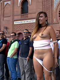 Saucy Spanish Slut Dragged Around the Streets of Madrid : Hot slut Camil is dragged around town by sexy Sandra Romain. Shes humiliated with her tits out crawling around a busy outdoor cafe. Then shes shown off in front of Plaza de Toros with her panties around her ankles. After much humiliation, shes put in full latex and taken to an underground club where a huge cock is waiting for her. There she is punished and fucked for all to see.