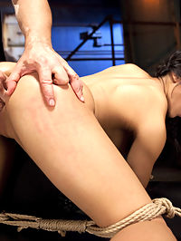 Mia Lis First Anal Bondage : When Mia Li shows up to todays shoot, she lifts up her skirt and reveals a plug in her ass. Shes been wearing it all morning, and cant wait to get tied up in it. This is her first time doing anal on camera - an anal slut in training!We start out with a back breaking pole tie that presents her tits for clips, and her pussy for the crotch rope. Rough rope grinding against her tender clit makes her squirm but the position is just too much for her and we cut it short.When it is time to get back on the horse, Mia is tied tight spread eagle and fucked hard with a dick on a still till she is all orgasmed out. And for desert, the shocker tied doggie style and stuffed with two in the pussy and one in the ass. Happy HogTied, Mia.