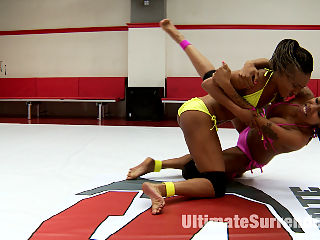 Fit Ebony Feather Weights Duel for the Ultimate Prize : Two skinny dark babes battle it out on the US mats. The Shit talk doesnt end when the wrestling stops. The Bratty loser cant keep her mouth shut and taunts the winner during the Prize round, antagonizing the winner to fuck her harder and dunk her into an ice bath