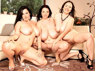Girls Who Love Girls : The last time Joana, the Countess of Cleavage, and her girls Roxanne Diamond and Amorina got together for a Big Tit Pussy Picnic at iSCORELANDi, they were in a quiet park where there was a strong chance of accidental exposure or someone spying on their sexing.br br This time, the three amigas decide to hold an indoor slumber party love-in minus the slumber and minus the nightgowns. This time, the girls are all dressed up in party dresses and heels.br br They waste no time with small chit-chat. Amorina kneels on the floor before Joana and pulls her top down. Roxanne cops a feel of Amorinas ass, then goes for a lip-lock with Joana. The dominant Joana takes Amorina and Roxanne by their hair and brings their faces together so they can kiss and swap tongue twirls. Joana watches their mouth-play with erotic pleasure.br br Instinctively, both girls pull off Joanas bra and each babe takes one of Joanas big tits between her hands. This emphasizes the sheer size of Joanas huge boobs. Their hands are tiny compared to Joanas hooters. Roxanne and Amorina each kiss and suck a nipple as Joana moans with excitement. She is their breast goddess they are her pleasure servants.br br Joana lies back on the couch, legs open. Roxanne hugs and kisses her while Amorina feels Joanas pussy through her panties, then pulls the panties to the side to examine her smooth, thick-lipped box thats ready to get juicy. Their three-way tits and slits worshiping has only just begun.